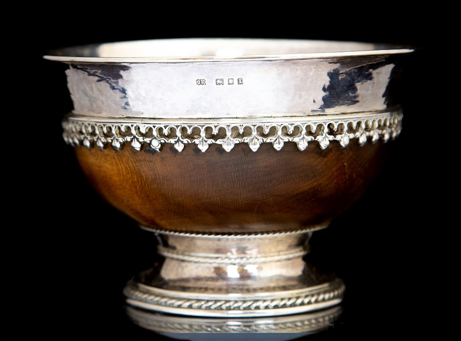 Lot 3 - Omar Ramsden; A George V Arts and Crafts Sterling silver mounted mazer bowl, London 1926, makers