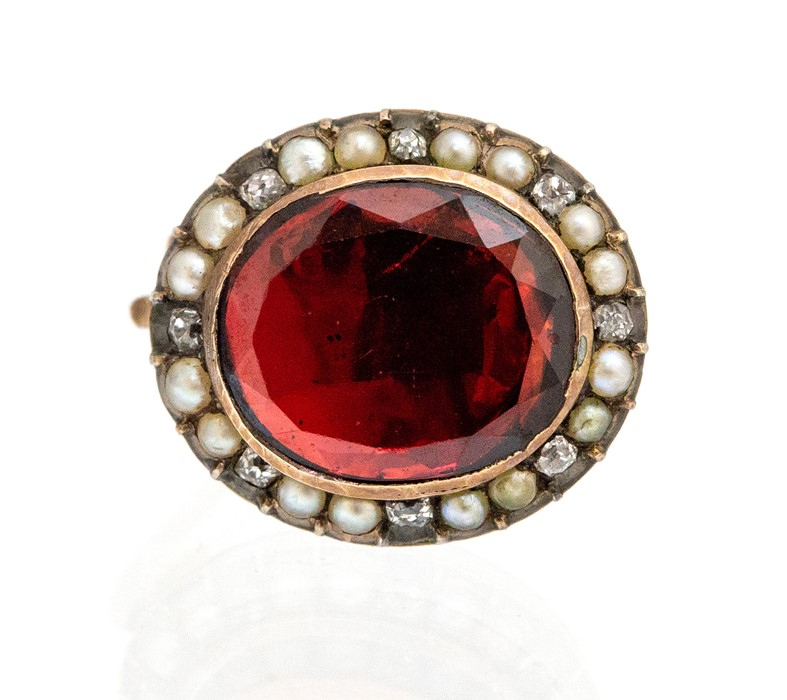 Lot 53A - A Georgian paste, seed pearl and diamond oval brooch, set with red foil backed paste stone, in an
