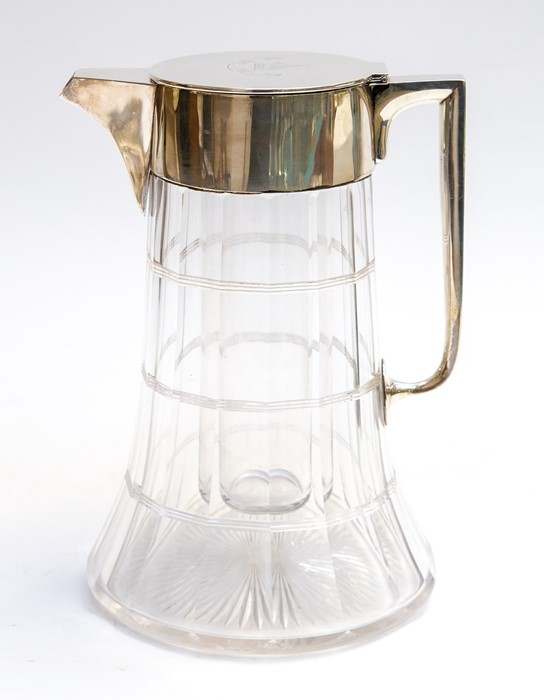 Lot 2 - An Edwardian silver mounted large water jug with faceted cut glass body and glass silver mounted