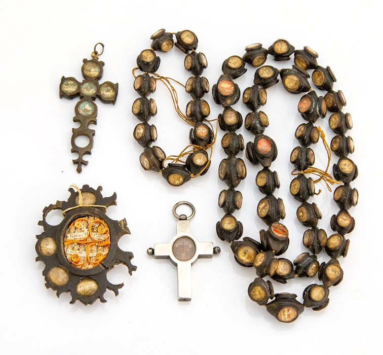 Lot 50 - An 18th century reliquary rosary, each bead with four glazed panelscontaining what is possibly