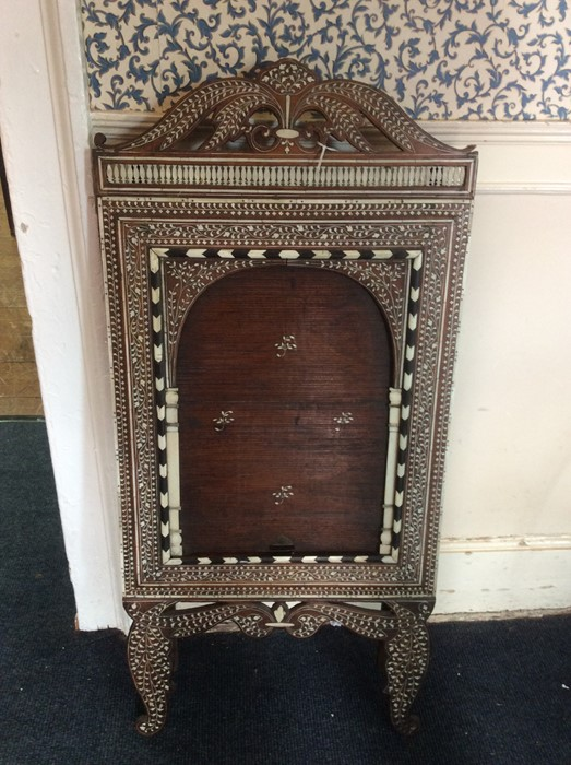 Lot 2295 - An early 20th Century Indian rosewood and bone inlaid mirrored screen, the front fitted with a