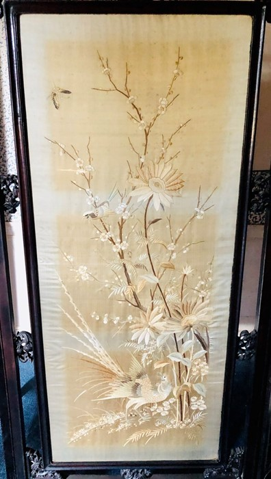 Lot 2085 - A late 19th Century Chinese hardwood triple panel dressing room screen, fret carved frame, inset