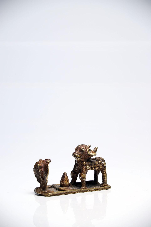Lot 45 - House ShrineBronzeIndia18th ctH: 5 cmLittle house shrine probably depicting Nandi the white bull and
