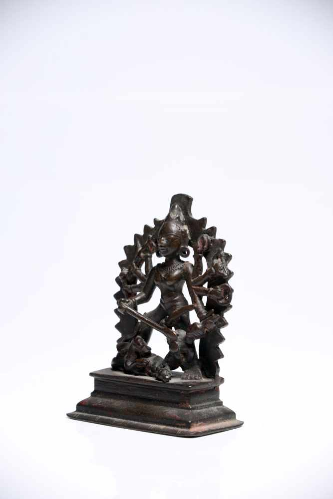 Lot 37 - DurgaBronzeSouth India16th ctH: 10 cm Durga is the warrior goddess also popular by the name Kali.