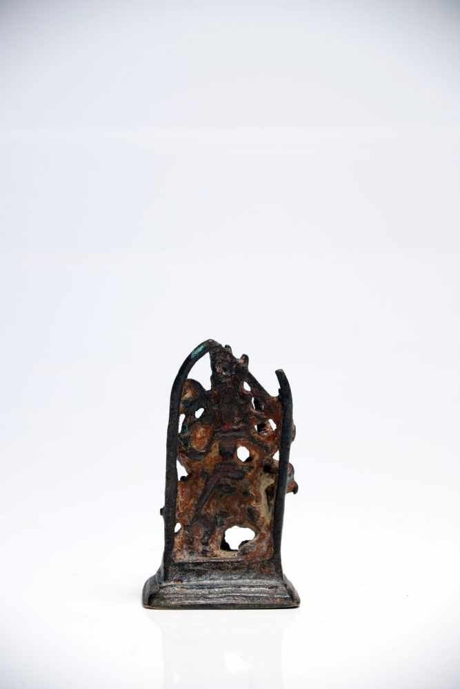 Lot 46 - DurgaBronzeIndia14th ctH: 8 cmThis little Bronze figure shows Goddess Durga with her mount, the