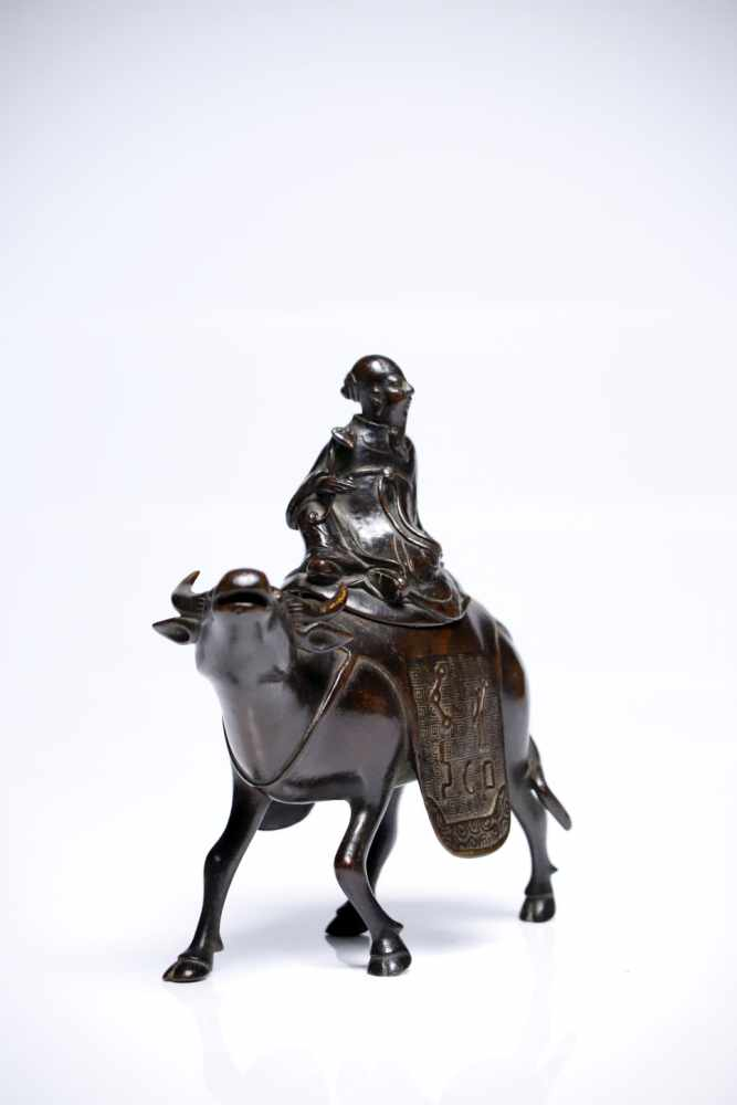 Lot 14 - Incense BurnerBronzeChina17th ctH: 17 cmLaozi, the Sage philosopher, sitting comfortably on a