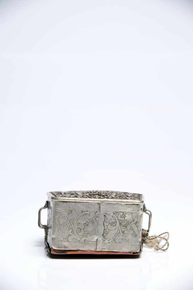 Lot 32 - Gau with Clay SculptureSilver and CopperTibet18th ctH: 10 cmThis little prayer box contains a clay