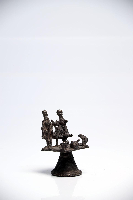Lot 44 - House ShrineBronzeIndia 17th ctH: 6,5 cmLingam and Yoni and Shiva with his family Ganesha, Naga