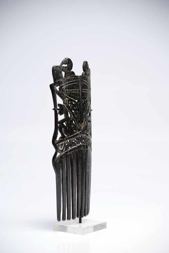 Lot 24 - Hair CombHornIndonesia19th ctH: 19 cmProbably made from water buffalo horn, this comb features