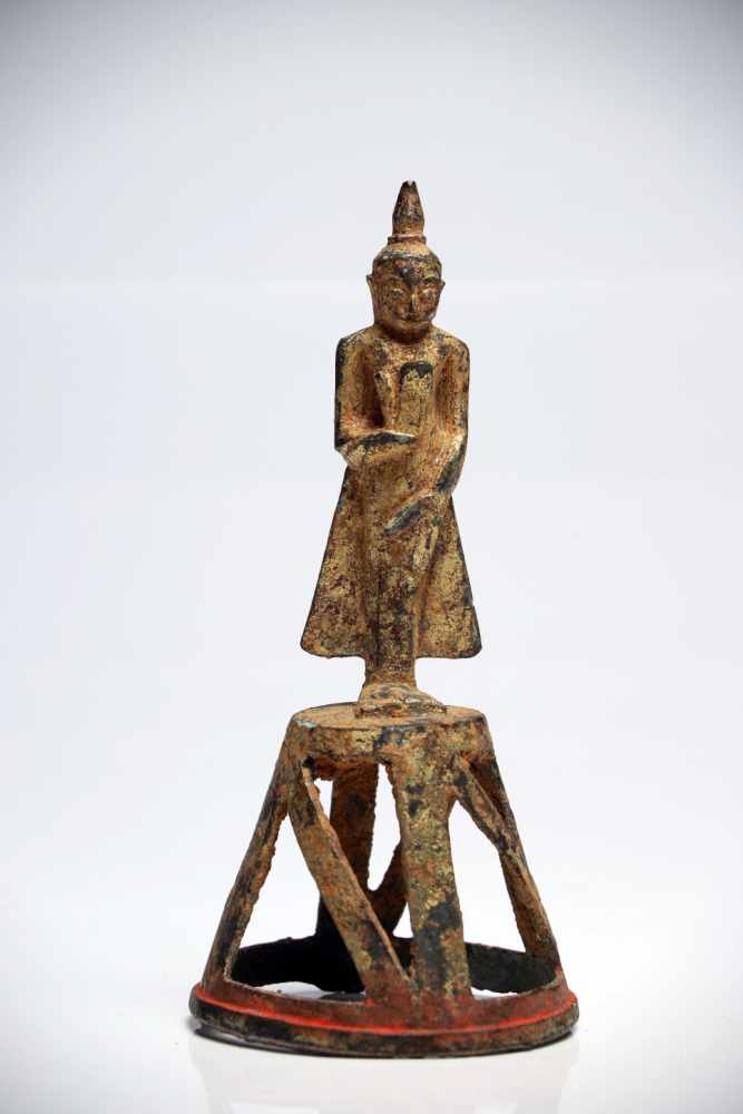 Lot 33 - Standing BuddhaBronzeBirma16th ctH: 16 cmBuddha statue from the Ava period, standing on a cone-