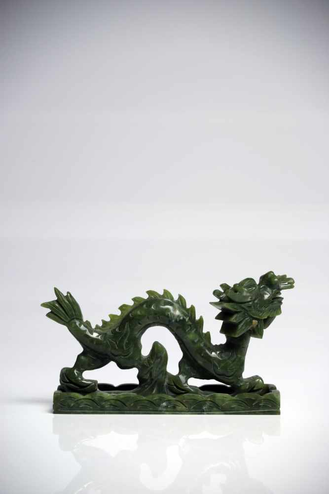 Lot 18 - DragonJadeChina20th ctL: 15 cmA Chinese dragon in motion with opened mouth, standing on a cloud, his