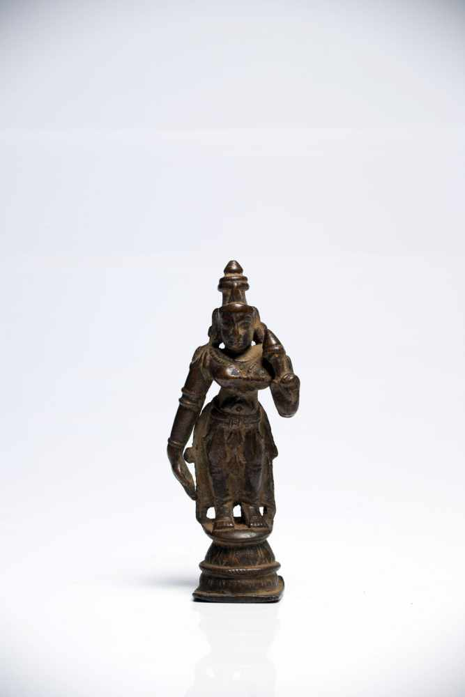 Lot 47 - ParvatiBronzeIndia18th ctH: 10 cmParvati is usually seen as the main support and wife of Shiva.