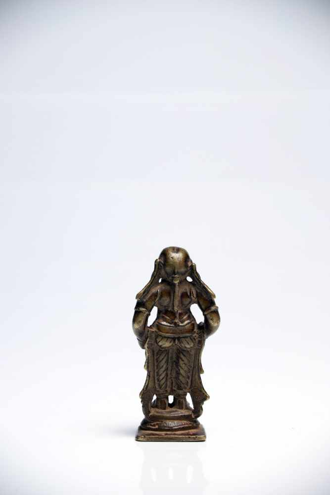 Lot 43 - Female DeityBronzeIndia16th ctH: 8 cmA standing deity dressed in dhoti, holding two objects in