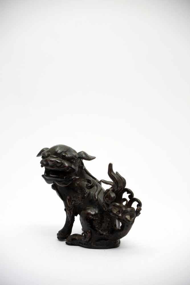 Lot 3 - Fu-DogBronzeChina18th ctH: 9 cm Fu-Dogs are often situated at temple entrances as guardian lions.