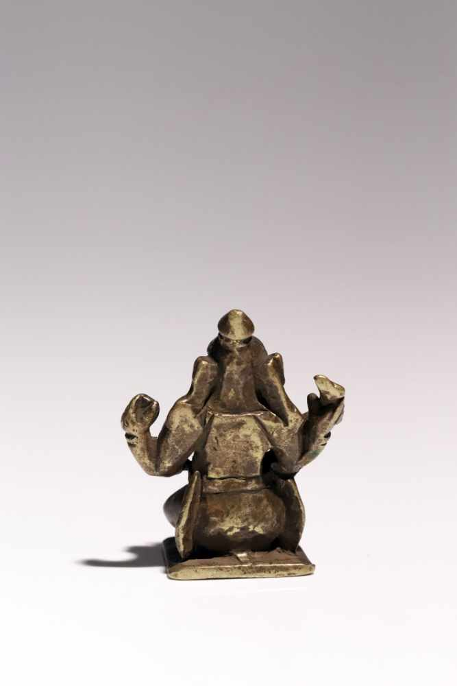 Lot 58 - Ganesha on NandiBronzeIndia17th ctH: 6 cmGanesha riding on white bull Nandi. In his two raised hands
