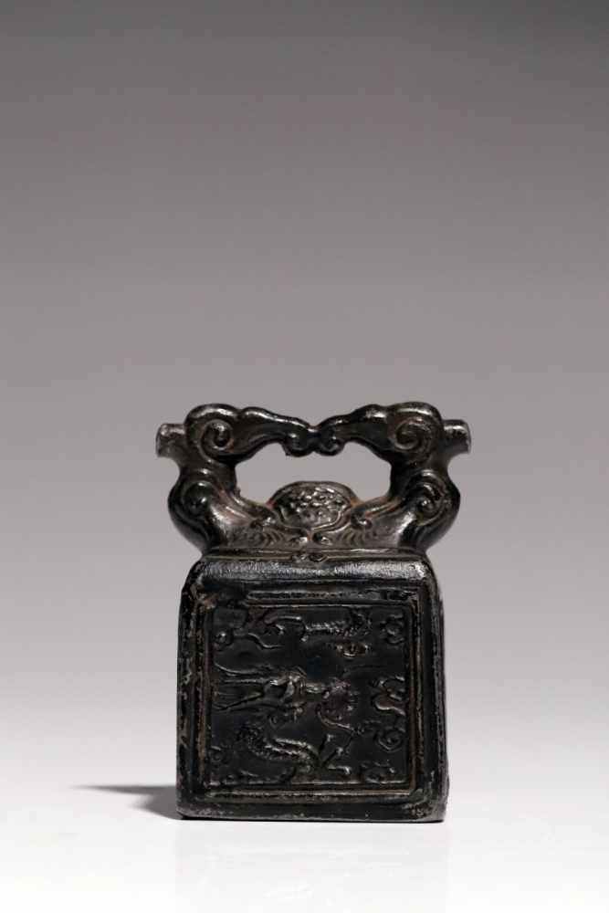 Lot 60 - SealTinChina18th ctH: 8 cmA Chinese seal stamp made of tin. The sides are decorated with a
