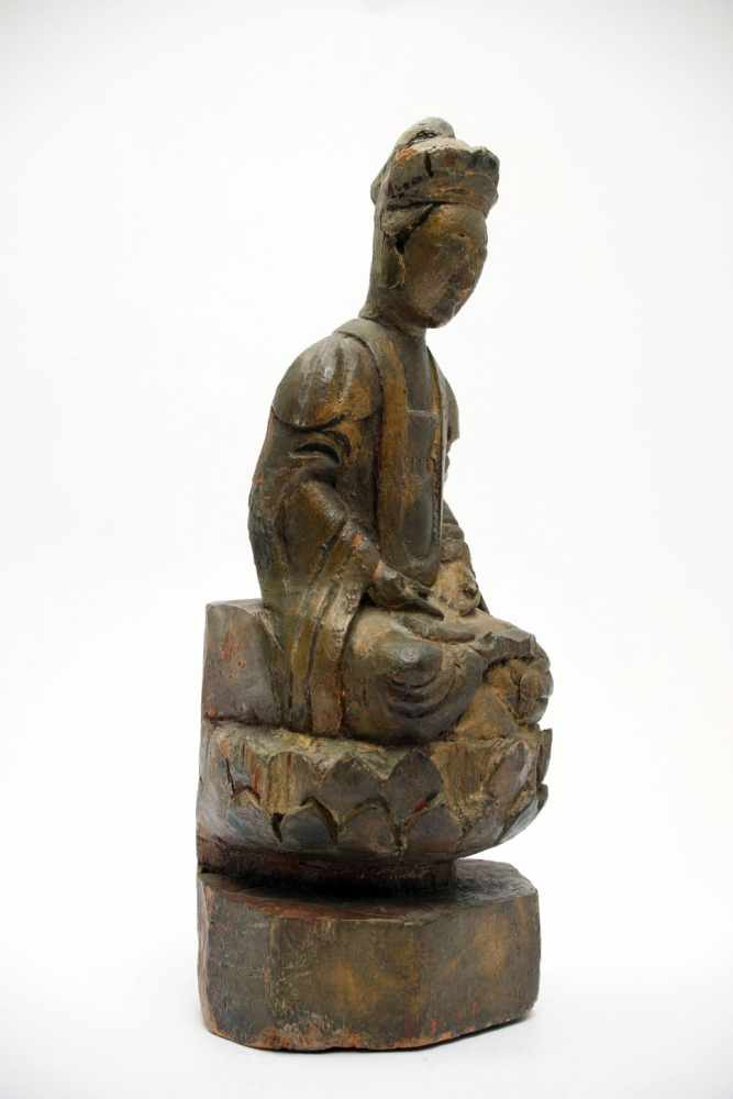 Lot 4 - ScholarWood carvingChina 19th ctH: 25 cmBodhisattva in lotus seat on a lotus patel with hands in