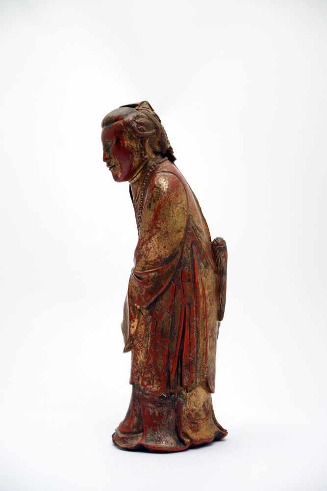Lot 6 - ScholarWood red paintedVietnam18th ctH: 32 cmThis red and gold lacquered statue shows a scholar in a
