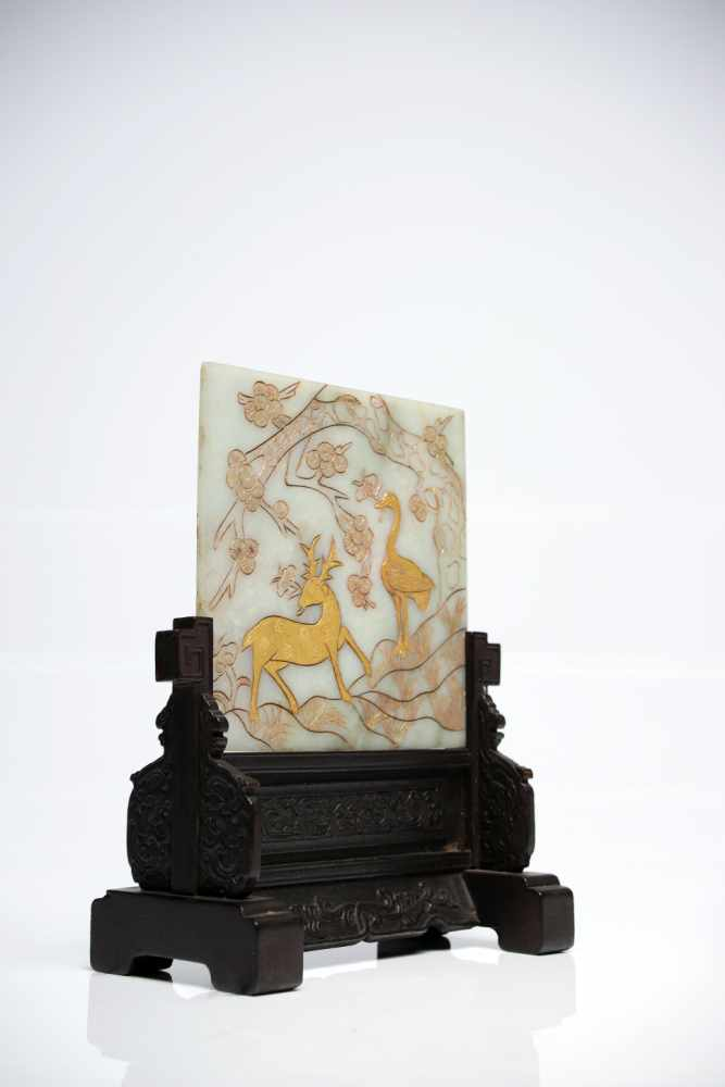 Lot 29 - Table ScreenJade carved an gildedChina18th ctH: 23 cmThe white jade screen shows a blossoming