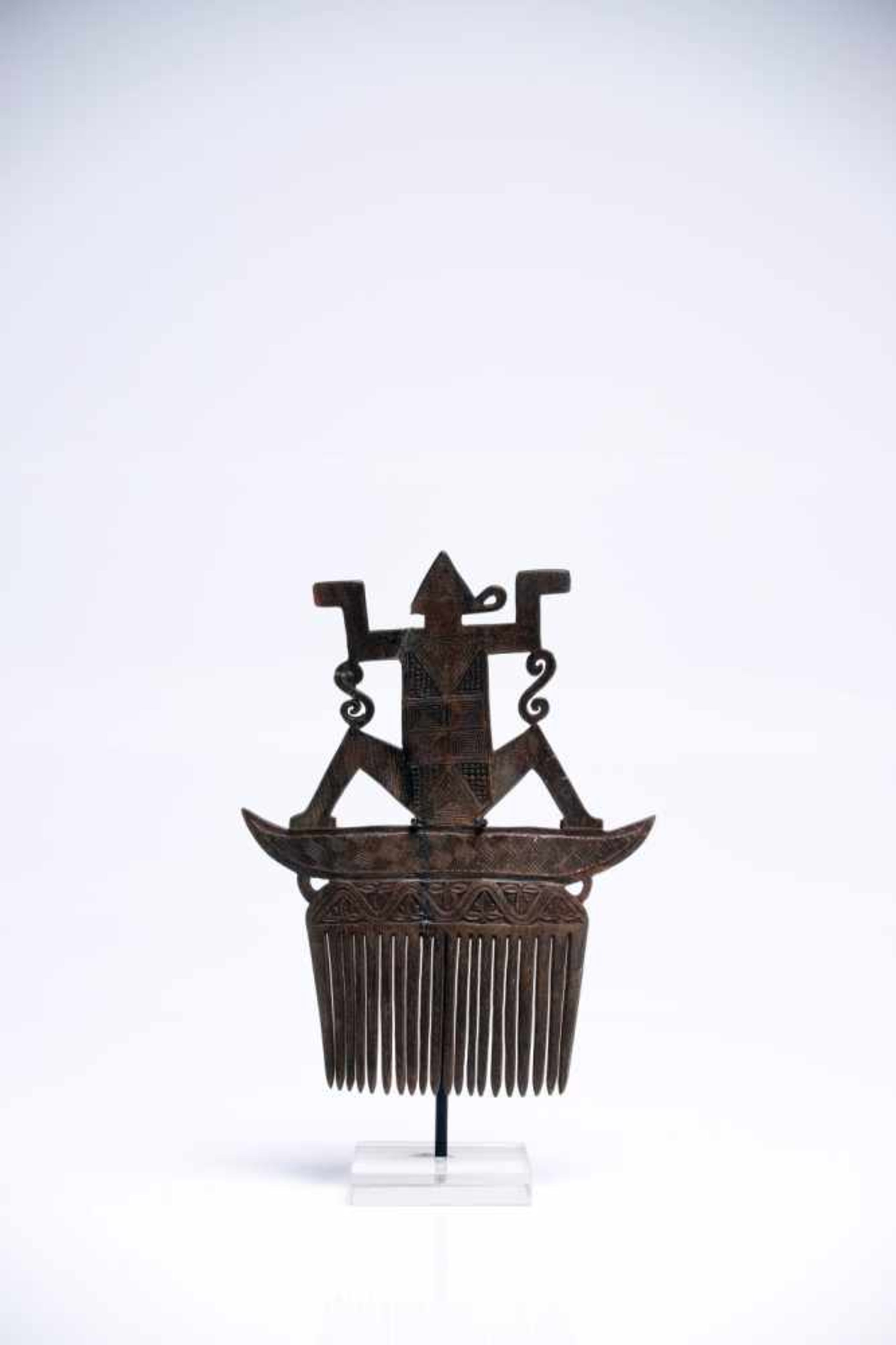 Lot 23 - Hair CombHornIndonesia19th ctH: 13 cmDelicately engraved hair comb. A human-like figure is sitting