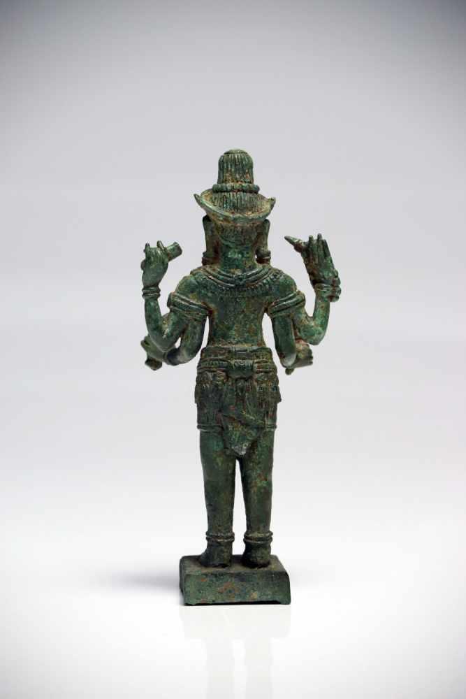 Lot 7 - LokeshvaraBronzeCambodia12th ctH: 15 cmThis four-armed lokeshvara is holding a lotus bud, a bumpa,