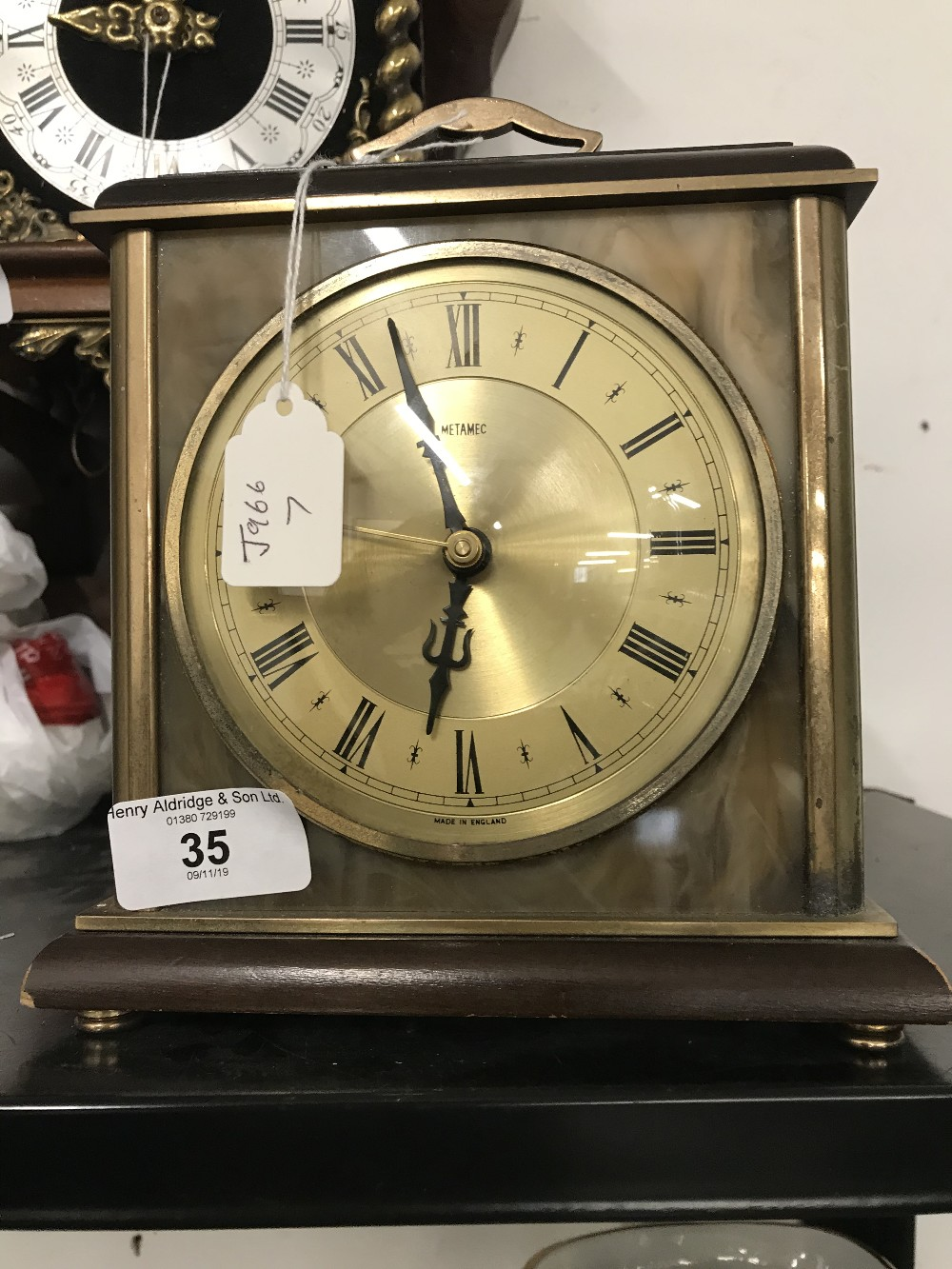 Lot 35 - Clocks: 20th cent. Onyx, brass and treen electronic Metamec clock.