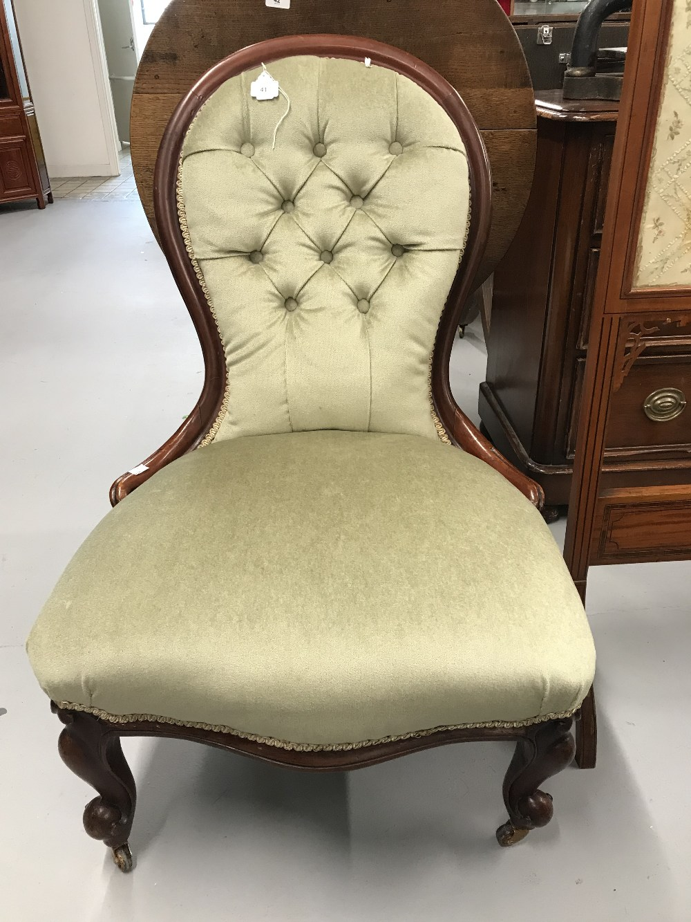 Lot 41 - 19th cent. Mahogany balloon backed nursing chair on cabriole supports with simple brass castors.