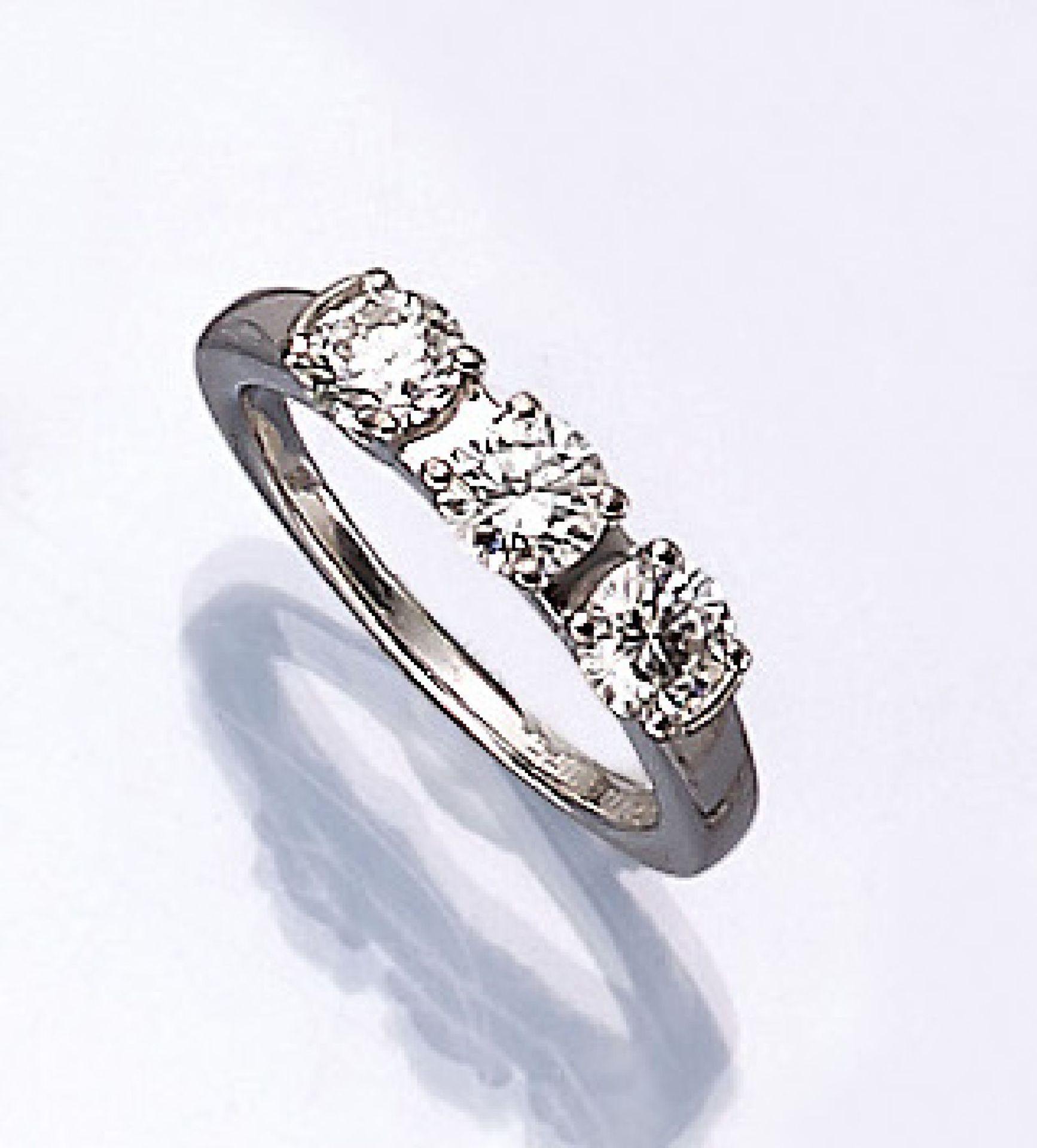 WEMPE Ring mit Brillanten, WG 750/000, 3 Brillanten zus. ca. 0.93 ct feines Weiß/lr, RW 47.5,
