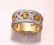 Ring mit Saphiren und Brillanten, GG/WG 750/ 000, ovalfacett. Saphire zus. ca. 0.60 ct, gelb,
