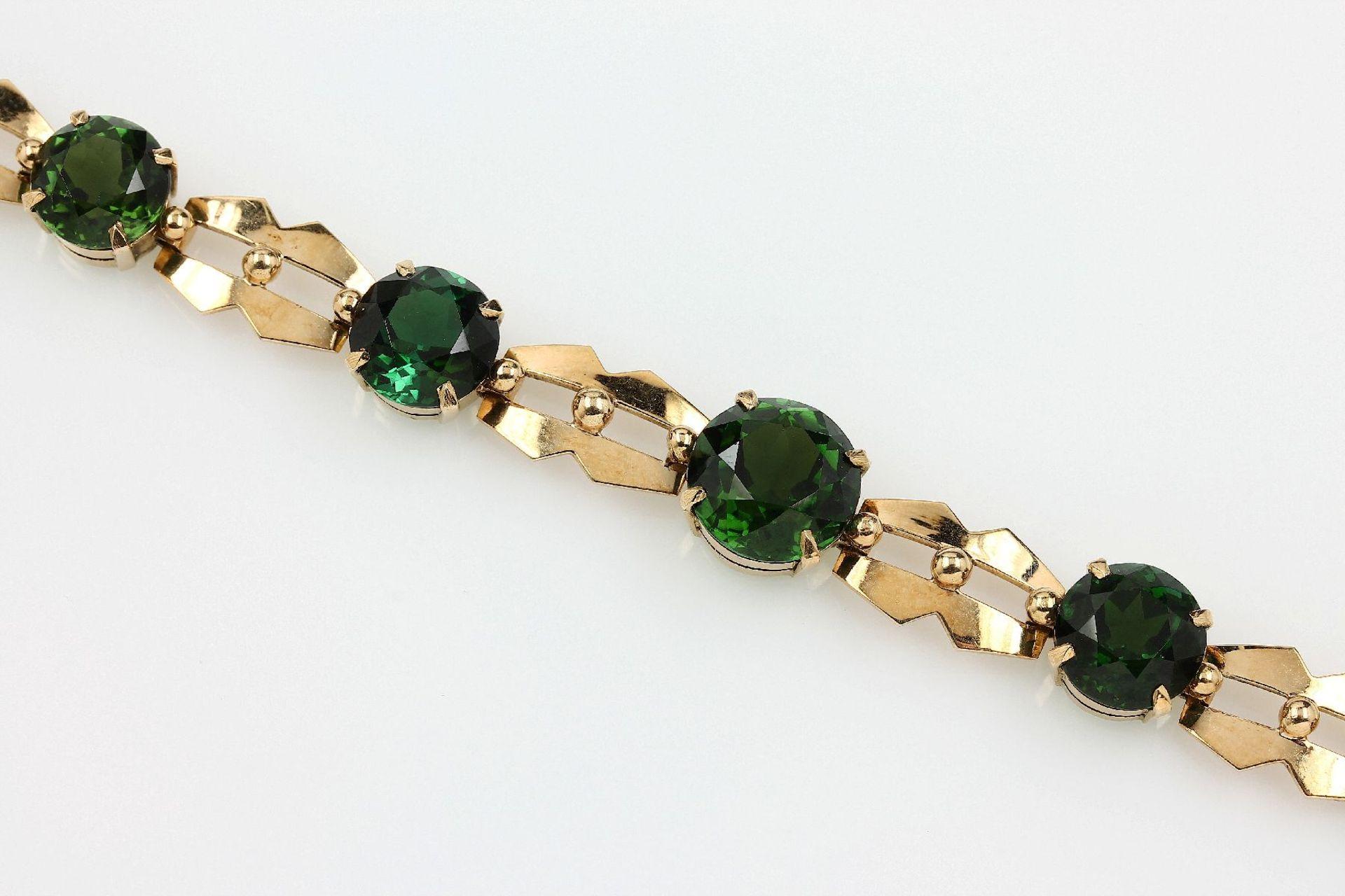 Los 21547 - 18 kt Gold Armband mit Chromdiopsiden, GG 750/000 gepr., 7 rundfacett. Chromdiopside zus. ca. 28.
