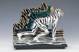 """Porzellanobjekt Rosenthal """"Tigermann"""" von Salomé, Porzellan, bunt bemalt, signiert und num. 29/75,"""