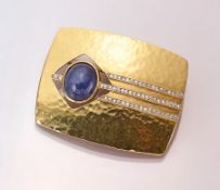 18 kt Gold Brosche mit Tansanit und Brillanten, GG 750/000, Tansanit-Cabochon ca. 10.06 ct,