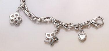 CHOPARD 18 kt Gold Bettelarmband mit Diamanten WG 750/000, bez. Le Chaines, 3 Blütenabhängungen