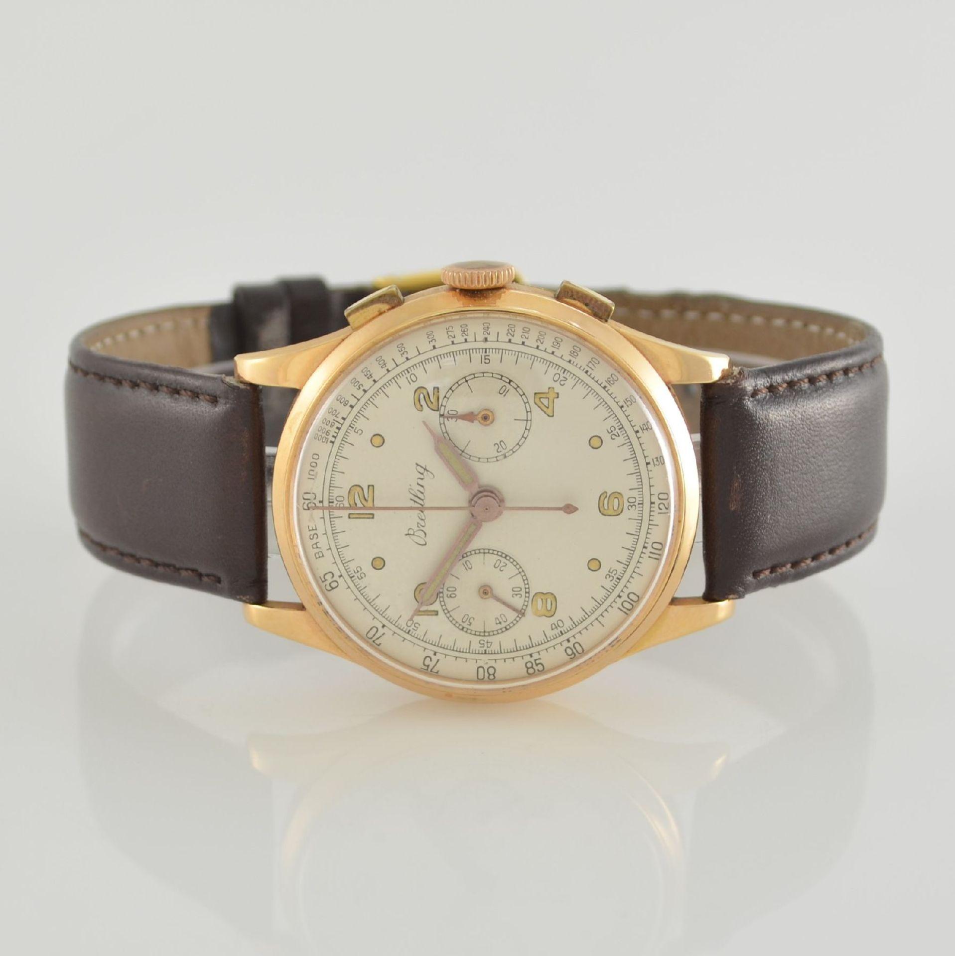 Herrenarmbanduhr mit Chronograph in 750/000 RoseG, Schweiz um 1950, Boden & Glasrand aufgedr., rest.