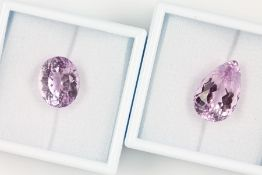 Lot 2 lose Kunzite, zus. ca. 40.3 ct, best. aus: 1 x tropfenf. facett. und 1 x oval facett.