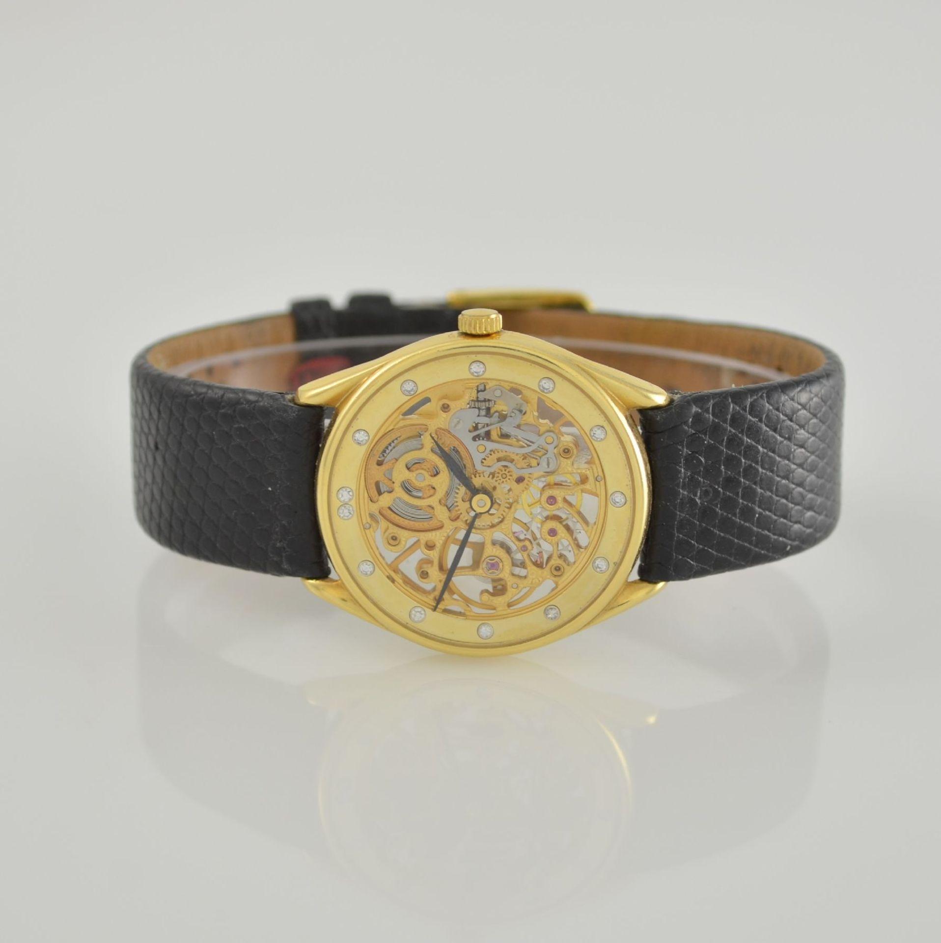 Skelettierte Armbanduhr in GG 750/000, Schweiz 1980er Jahre, Zifferblatt m. 12 Diamant-Indexen,