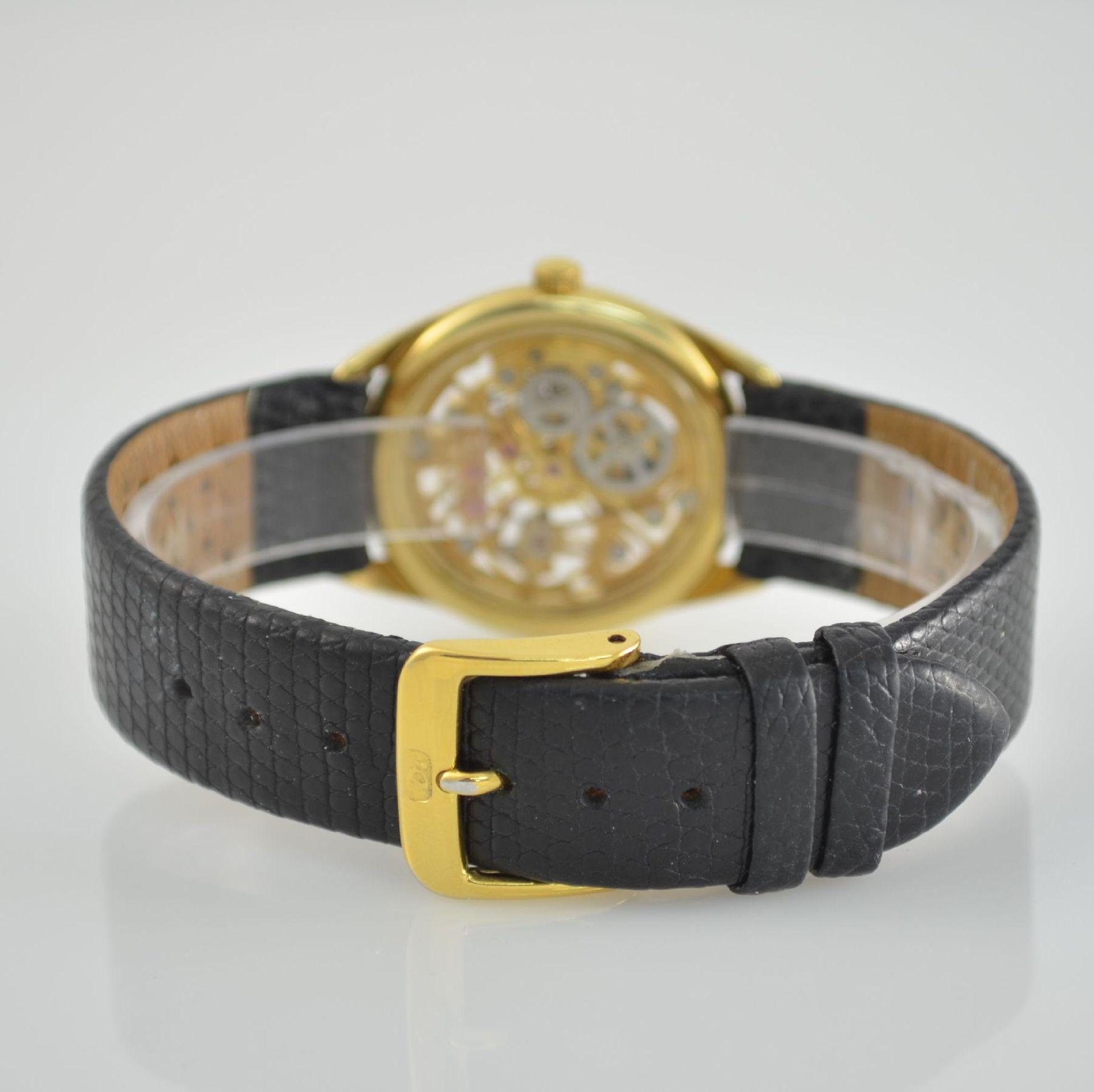 Skelettierte Armbanduhr in GG 750/000, Schweiz 1980er Jahre, Zifferblatt m. 12 Diamant-Indexen, - Bild 5 aus 6