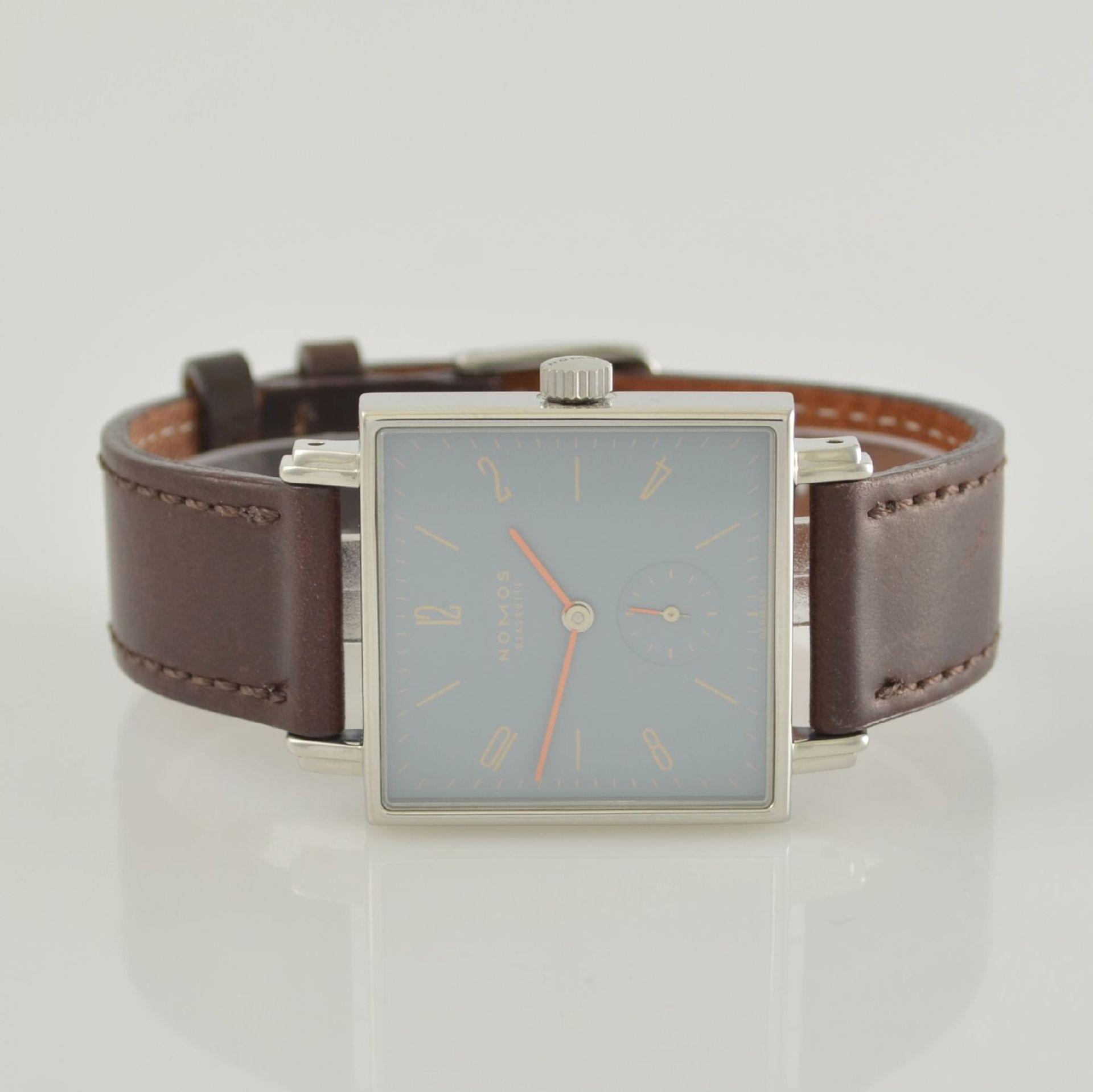 NOMOS Tetra Adonisröschen Armbanduhr in Edelstahl, Deutschland um 2010, Handaufzug, quadratisches