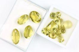 Lot lose facett. Lemon-Quarze, zus. 220 ct, (beh.), in versch. Schliffformen und Größen, überwiegend