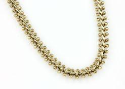 14 kt Gold Collier, ca. 33.8 g, GG 585/000, ausgefallene Formgebung, Enden mit Granulaten, L. ca. 44