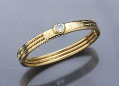 "18 kt gold CHOPARD bangle ""Happy Diamond"" withdiamond , YG 750/000, 1 movable diamond under glass,"