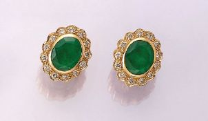 Pair of 18 kt gold earrings with emeralds and brilliants , YG 750/000, oval bevelled emeralds