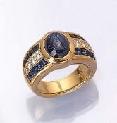 18 kt gold ring with sapphires and brilliants , YG 750/000, centered oval sapphirecabochonapprox.