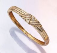14 kt gold bangle with diamonds , YG 585/000, 72 brilliants and 104 diamond baguettes respectively-