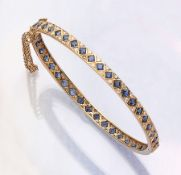 18 kt gold bangle with sapphires and brilliants , YG 750/000, 44 bevelled sapphires total approx.