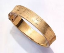 14 kt gold bangle, approx. 51.5 g , filled, YG 585/000, struct. and engraved, diam. approx. 6.2 x