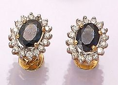 Pair of 18 kt gold earrings with sapphire and brilliants , YG 750/000, oval bevelled sapphires total