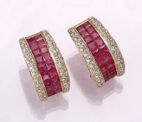 Pair of 18 kt gold earrings with rubies and brilliants , YG/WG 750/000, centered ruby squares