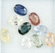 9 oval bevelled sapphires total approx. 5.15 ct, fancy coloured Valuation Price: 430, - EUR