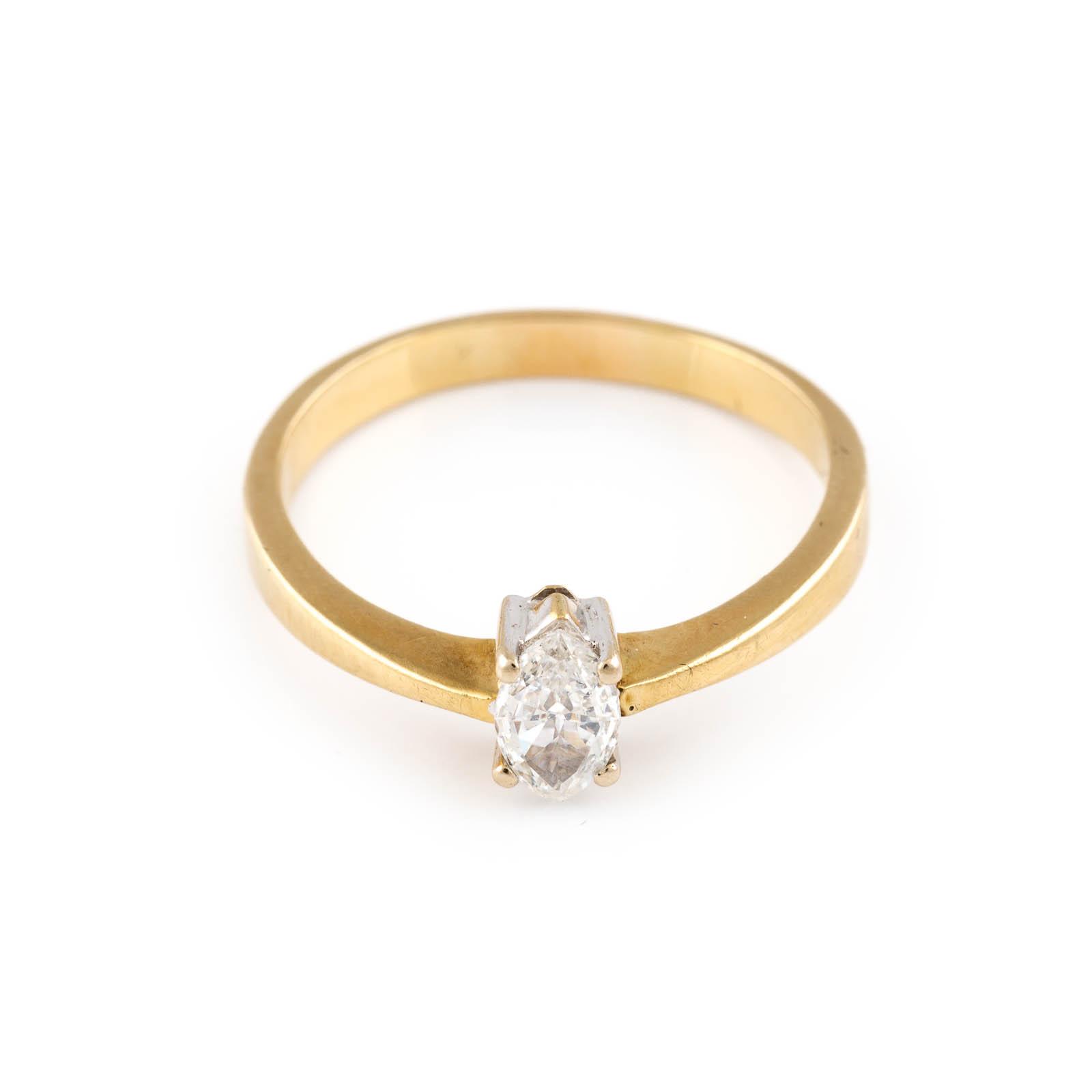 Lot 15 - DIAMANT-RING Gelbgold. Ringmaß ca. 61,5 cm, Ges.-Gew. ca. 3,8 g. Gest. 750. Ein Diamant-Navette, ca.